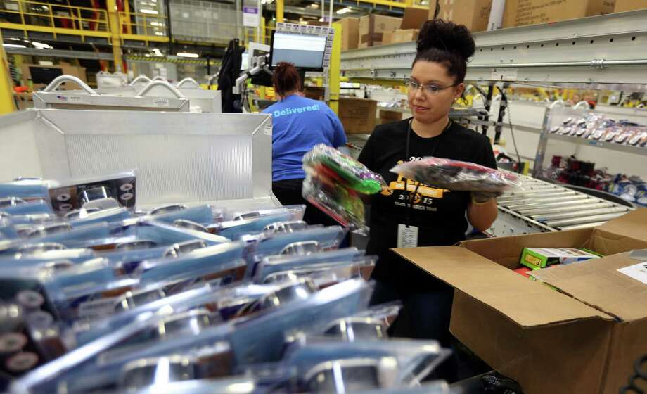 An Amazon worker on the floor of a Kenosha, Wis. fulfillment center in March 2016. On March 21, 2018, LinkedIn named Amazon the most sought-for U.S. employer based on interactions on LinkedIn pages. (Phil Velasquez/Chicago Tribune/TNS) Photo: Phil Velasquez / TNS / Chicago Tribune