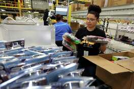 An Amazon worker on the floor of a Kenosha, Wis. fulfillment center in March 2016. On March 21, 2018, LinkedIn named Amazon the most sought-for U.S. employer based on interactions on LinkedIn pages. (Phil Velasquez/Chicago Tribune/TNS)