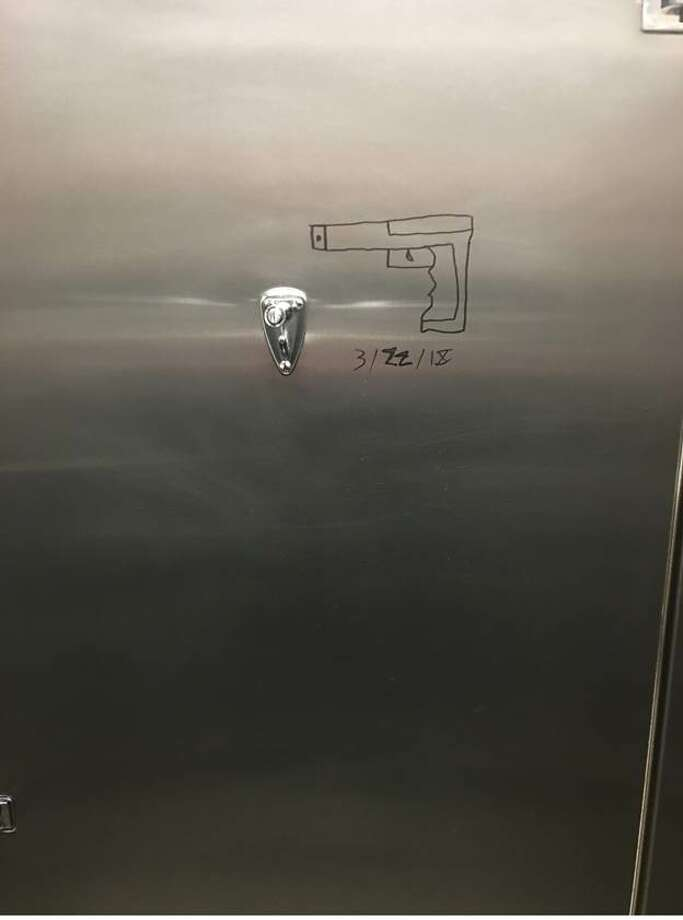 On March 20, Delta College Public Safety was made aware of a concerning drawing located inside of a bathroom stall door. The drawing was located in the E – Wing Men's bathroom. The drawing depicted an image of a handgun with numbers, letters or symbols written beneath it. Some have perceived this writing to be the date 3/22/18. (Photo provided)