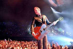 INGLEWOOD, CA - DECEMBER 09: Singer Josh Homme of the band Queens of the Stone Age performs onstage during KROQ Almost Acoustic Christmas 2017 at The Forum on December 9, 2017 in Inglewood, California.