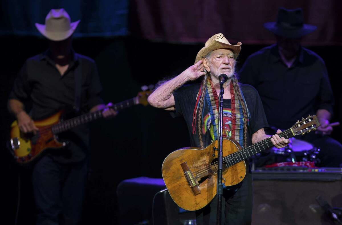 Willie Nelson plays for a pack audience at the Smart Financial Centre in Sugar Land on Tuesday, Nov. 14, 2017. (Annie Mulligan / Freelance)