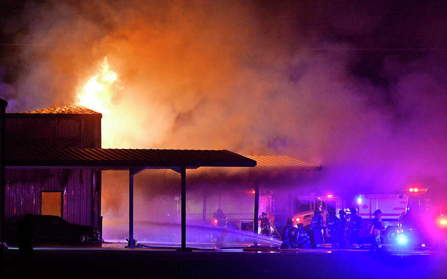Midland County emergecy responders work to put out a fire at New Wave Energy Services on South County Road 1270 late on the night of March 20, 2018. James Durbin/Reporter-Telegram Photo: James Durbin
