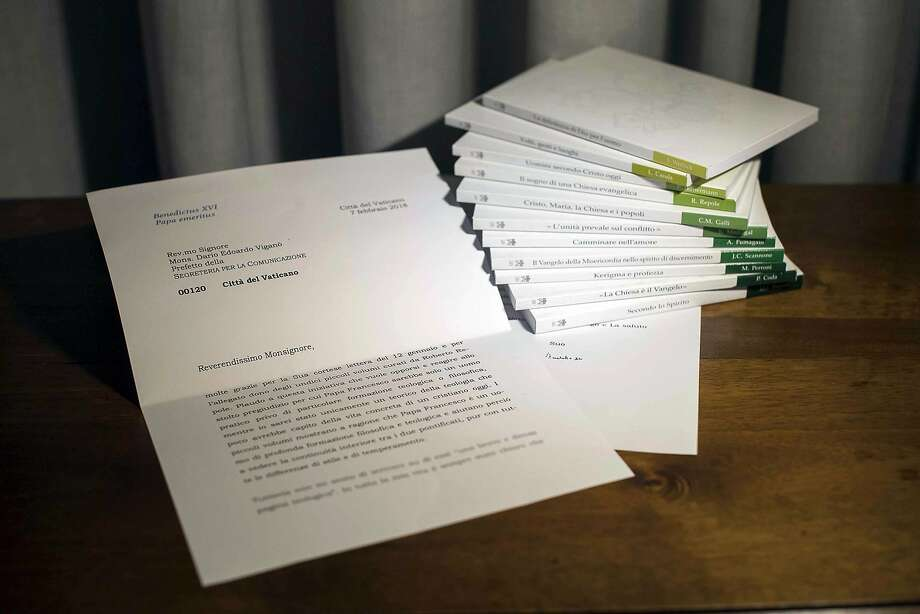 A letter by retired Pope Benedict is seen in this photo released on March 13, 2018 that the Vatican admitted was doctored, by blurring its final two lines, where retired Pope Benedict begins to acknowledge that he didn't read an 11-volume set of books about Pope Francis' theology, seen at right, and doesn't have time to comment them. On Wednesday, March 21, 2018, the Vatican announced that head of Vatican's communications department, Mons. Dario Vigano', had resigned over a scandal about the letter that he mischaracterized in public and then digitally manipulated in this photograph sent to the media. (Vatican Media photo via AP, file) Photo: Associated Press