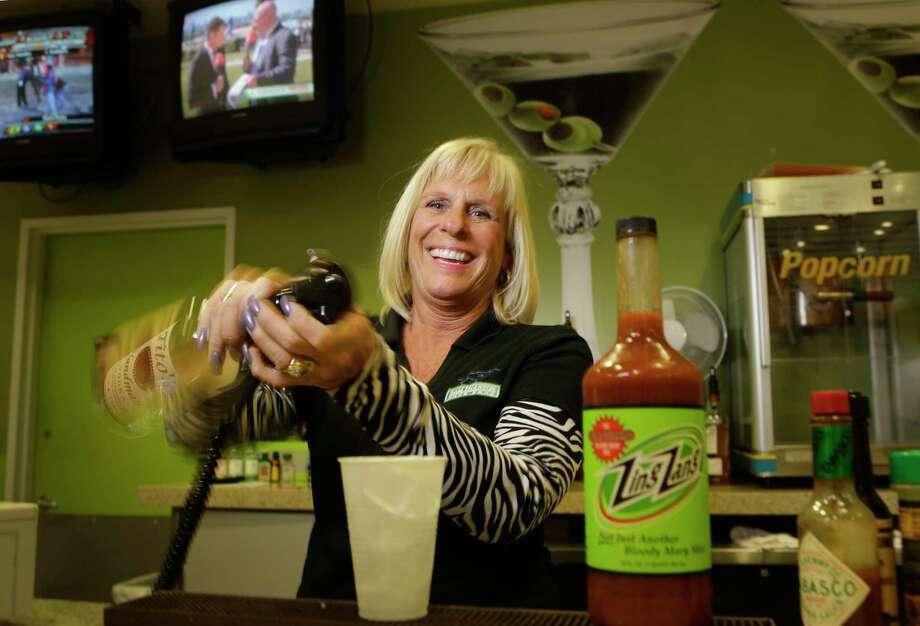 Bartender Debbie Moynihan is shown at Sam Houston Race Park, 7575 North Sam Houston Pkwy. W., Friday, March 9, 2018, in Houston. ( Melissa Phillip / Houston Chronicle ) Photo: Melissa Phillip, Staff / © 2018 Houston Chronicle