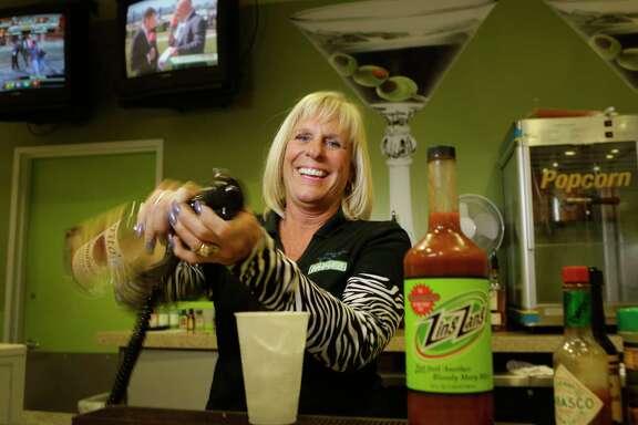 Bartender Debbie Moynihan is shown at Sam Houston Race Park, 7575 North Sam Houston Pkwy. W., Friday, March 9, 2018, in Houston. ( Melissa Phillip / Houston Chronicle )