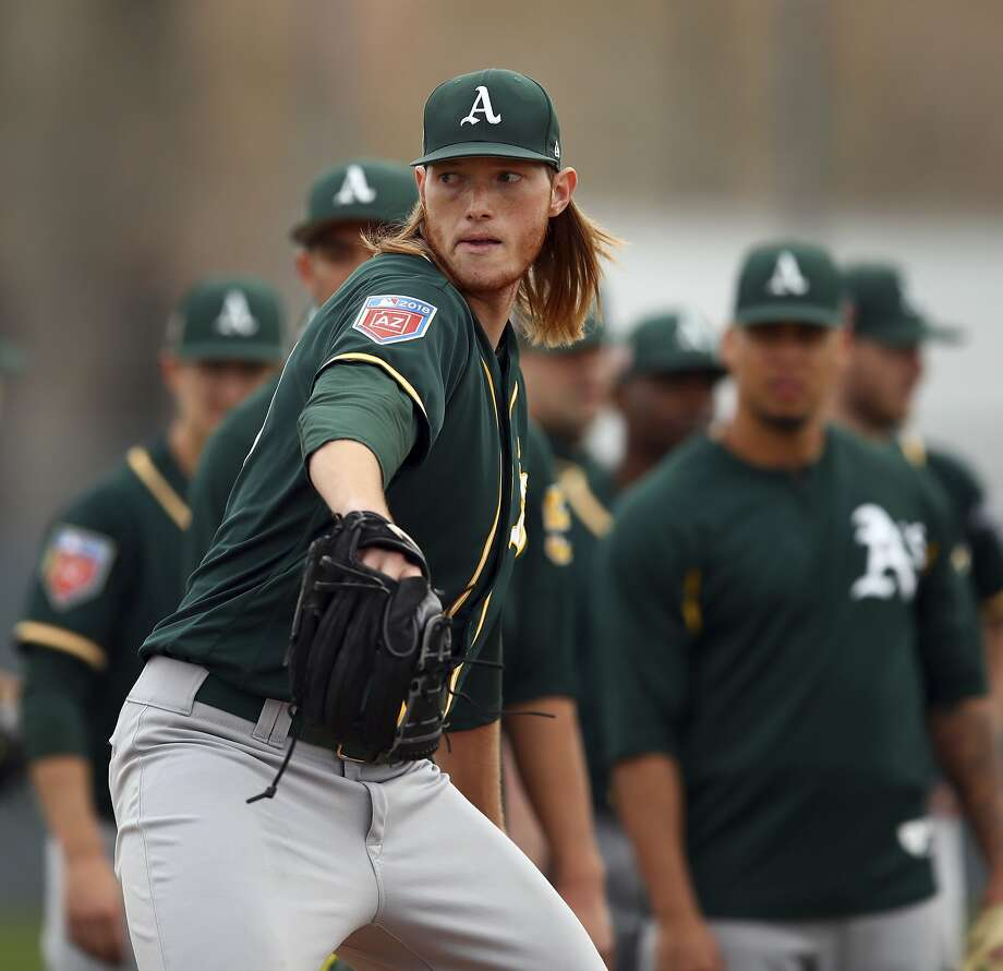 Oakland Athletics & # 39; A.J. Puk will attend a spring training baseball drill in Mesa, Arizona on Friday, February 16, 2018 (AP Photo / Ben Margot) Photo: Ben Margot / AP