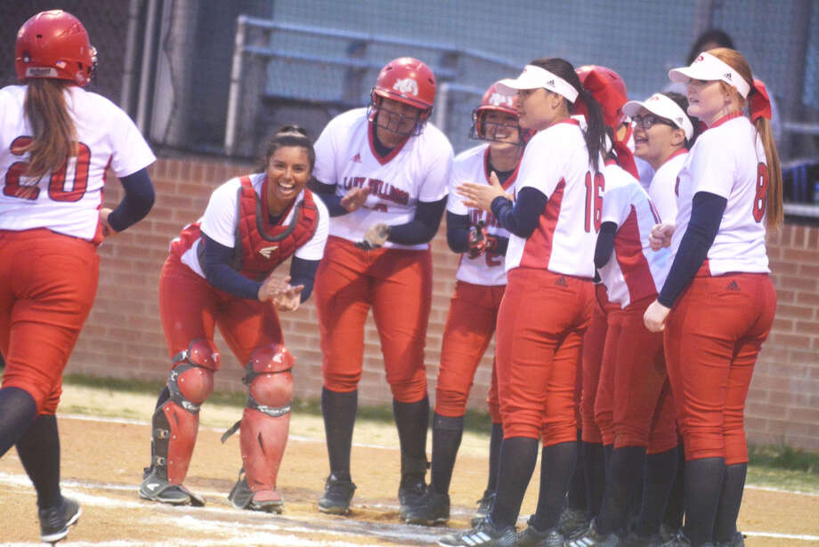 Plainview softball players line up to greet Gabby Godino (20) after she hit a home run in a game earlier this season. Godino belted two home runs and drove in five runs Tuesday to lead the Lady Bulldogs to a 10-2 victory over Caprock. Photo: Skip Leon/Plainview Herald