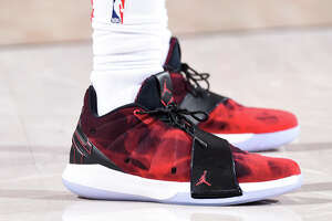PORTLAND, OR - MARCH 20:  Sneakers of Chris Paul #3 of the Houston Rockets during the game against the Portland Trail Blazers on March 20, 2018 at the Moda Center in Portland, Oregon. NOTE TO USER: User expressly acknowledges and agrees that, by downloading and or using this Photograph, user is consenting to the terms and conditions of the Getty Images License Agreement. Mandatory Copyright Notice: Copyright 2018 NBAE (Photo by Andrew D. Bernstein/NBAE via Getty Images)