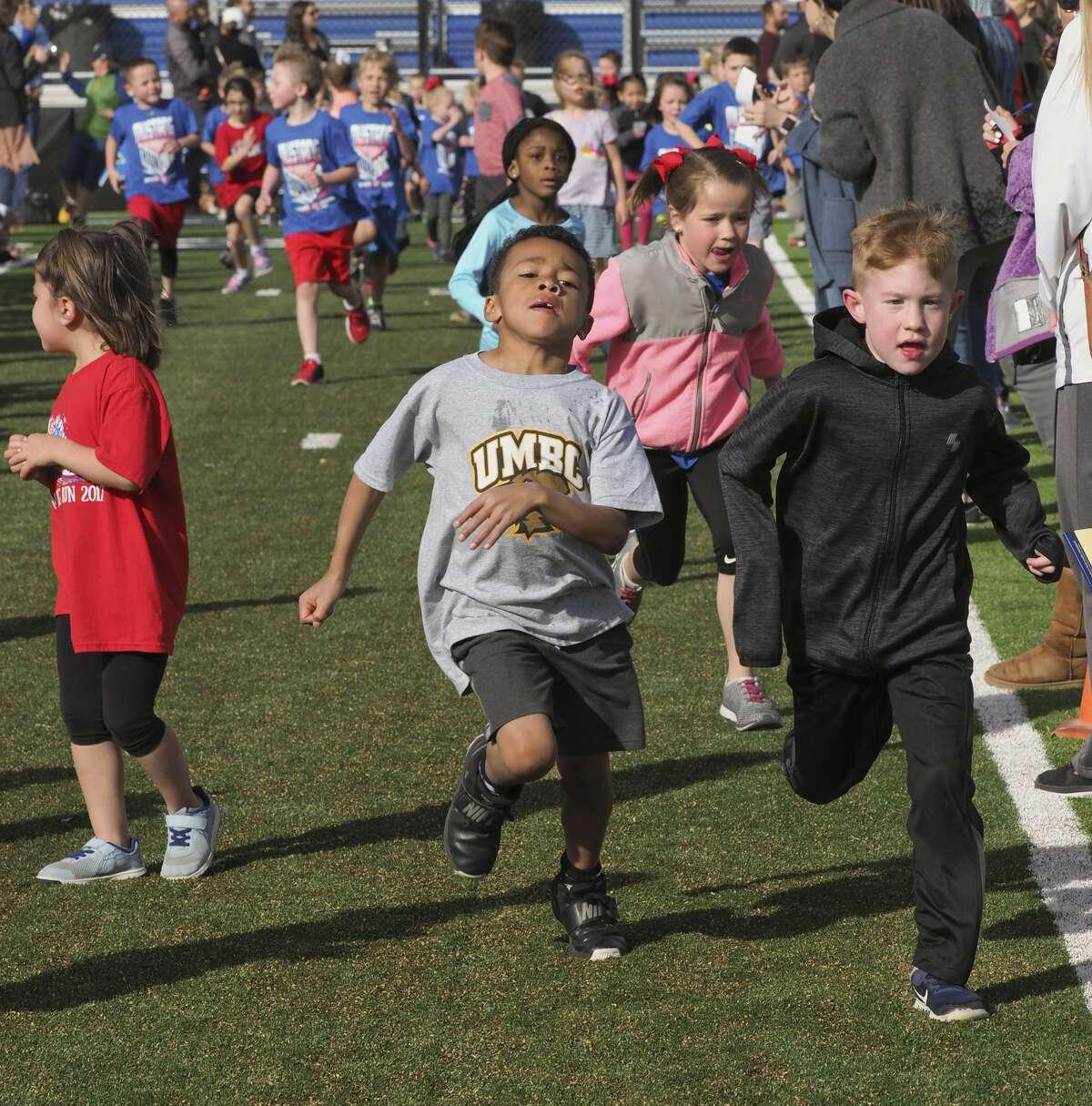 Midland Christian students run and walk around the football field 03/21/18. raising money during the Mustang Run. Tim Fischer/Reporter-Telegram