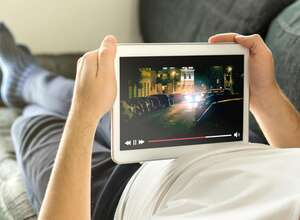 Online movie stream with mobile device. (Dreamstime/TNS)