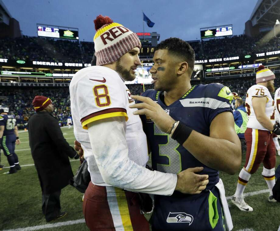 Seattle Seahawks quarterback Russell Wilson, right, greets Washington Redskins quarterback Kirk Cousins (8) after an NFL football game, Sunday, Nov. 5, 2017, in Seattle. The Redskins won 17-14. Photo: Elaine Thompson/AP