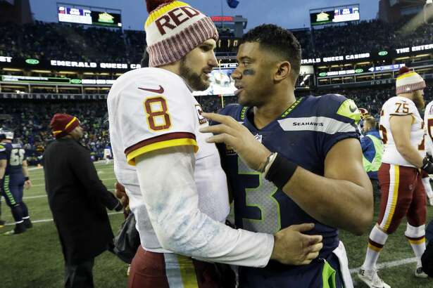 Seattle Seahawks quarterback Russell Wilson, right, greets Washington Redskins quarterback Kirk Cousins (8) after an NFL football game, Sunday, Nov. 5, 2017, in Seattle. The Redskins won 17-14. (AP Photo/Elaine Thompson)