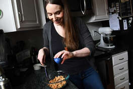 Recipe developer and food photographer Jennifer Farley works on roasted Salt-and-Pepper Cashews.