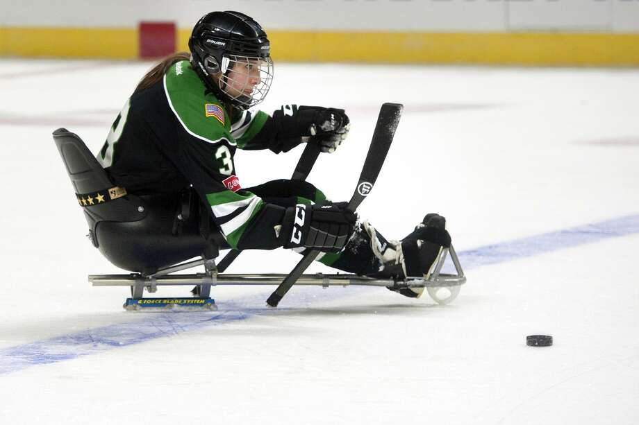 Lindsey Runkel, of Westport, a member of the Gaylord Wolfpack, moves a puck up the ice during a sled hockey scrimmage against the Bridgeport Sound Tigers at the Webster Bank Arena, in Bridgeport, Conn. March 21, 2018. Photo: Ned Gerard / Hearst Connecticut Media / Connecticut Post