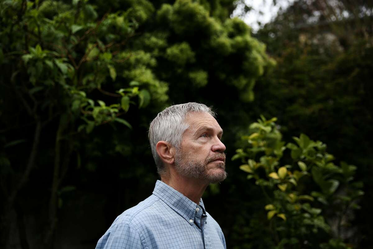 Tim Allen stands for a portrait in the backyard of his Bernal Heights home, Wednesday, March 21, 2018, in San Francisco, Calif. A new UCSF study shows a smartwatch app Cardiogram tracks a user's cardio activity and helps detect atrial fibrillation. Allen participated in the study.