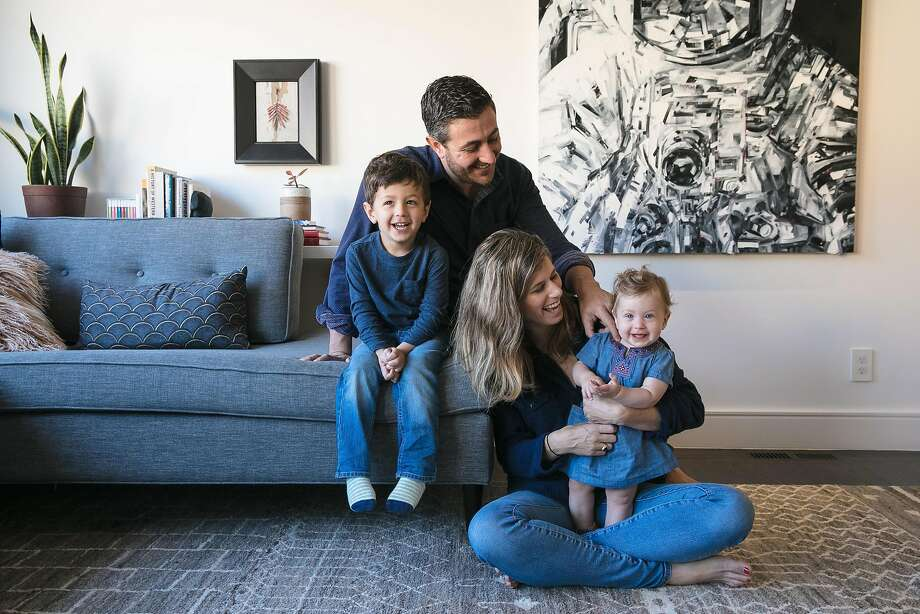 Andy and Ali Stein with their children Nate, 3, and baby Maya, have some family time in the living room of their S.F. home. Photo: Mason Trinca, Special To The Chronicle