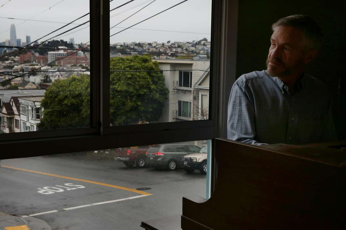 Tim Allen plays the piano at his Bernal Heights home, Wednesday, March 21, 2018, in San Francisco, Calif. A new UCSF study shows a smartwatch app Cardiogram tracks a user's cardio activity and helps detect atrial fibrillation. Allen participated in the study.