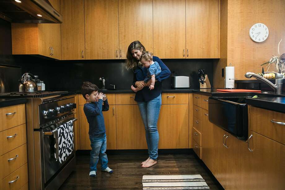 Ali Stein with her children, Nate and baby Maya, in the kitchen of her S.F. home. Photo: Mason Trinca, Special To The Chronicle
