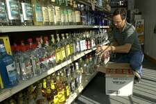 Texas law dictates that liquor stores cannot be open on Sundays. This is a relic - a remnant of antiquated blue laws. Here, Greg Tannery stocks shelves in his liquor store, 105 Package Store in 2003, in Conroe, Texas.