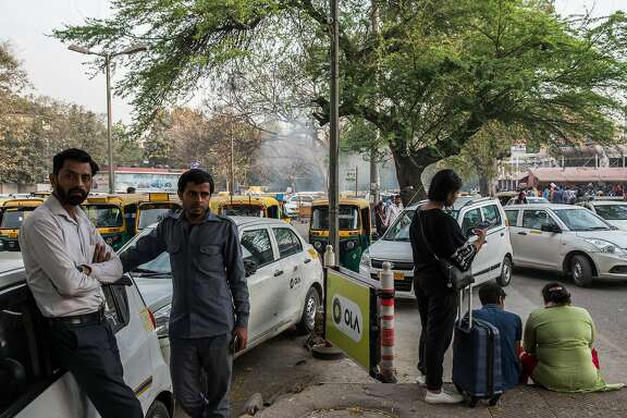 Drivers for Ola at a pick-up point in New Delhi, March 16, 2018. The Indian ride-hailing company Ola is challenging Uber in the Australian market, which it long had to itself. (Rebecca Conway/The New York Times)