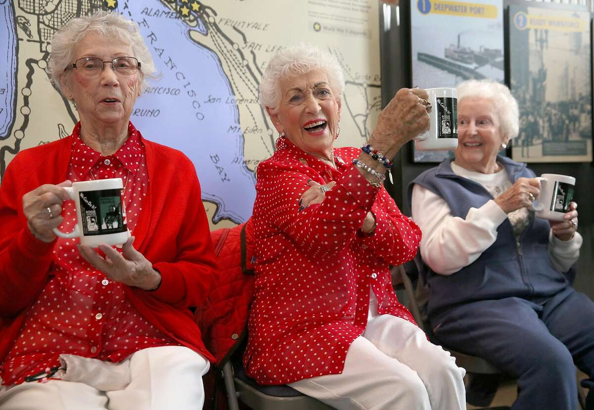 Left to right--Marian Souza (engineer drafts woman who made changes in blueprints for troop transports), Kay Morrison (drafts woman whose older sister also worked at the shipyard), and Josephine Lico (worked at an IBM office computing shipyard spending) receive commemorative cups at the Rosie the Riveter/World War II Home Front Visitor Education Center as the 2018 National Rosie the Riveter Day is recognized on Wednesday March 21, 2018, in Richmond, Calif.