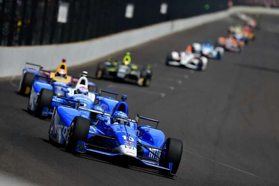 INDIANAPOLIS, IN - MAY 28:  Tony Kanaan of Brazil, driver of the #10 NTT Data Honda, leads a pack of cars during the 101st Indianapolis 500 at Indianapolis Motorspeedway on May 28, 2017 in Indianapolis, Indiana.  (Photo by Jared C. Tilton/Getty Images)