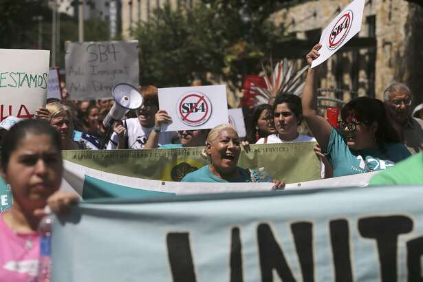 Protesters chant Sept. 1 during a march in downtown San Antonio against Senate Bill 4. A panel of federal judges at the Fifth Circuit Court of Appeals in New Orleans last week let much of the law take effect.