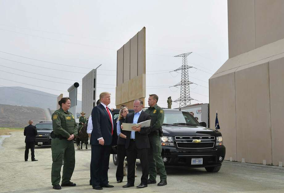 "President Donald Trump inspects border wall prototypes in San Diego, California on March 13. Donald Trump — making his first trip to California as president — warned there would be ""bedlam"" without the controversial wall he wants to build on the border with Mexico, as he inspected several prototype barriers. Its only utility, however, is allowing cartels to jack up human smuggling prices. Photo: MANDEL NGAN /AFP /Getty Images / AFP or licensors"