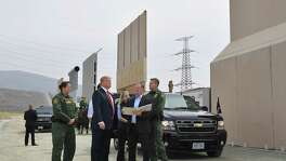"President Donald Trump inspects border wall prototypes in San Diego, California on March 13. Donald Trump — making his first trip to California as president — warned there would be ""bedlam"" without the controversial wall he wants to build on the border with Mexico, as he inspected several prototype barriers. Its only utility, however, is allowing cartels to jack up human smuggling prices."