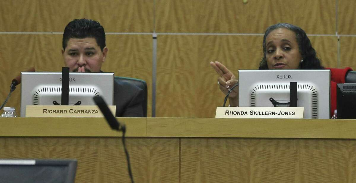 In this file photo, Houston ISD Superintendent Richard Carranza, left, and Trustee Rhonda Skillern-Jones listen during in a public meeting at Hattie Mae White Educational Support Center on Thursday, Feb. 8, 2018, in Houston. ( Yi-Chin Lee / Houston Chronicle )
