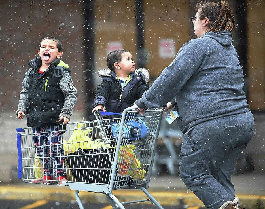 A little fella catches snowflakes on his tongue while riding in a shopping cart during the light snow at the Shop Rite in East Haven, Wednesday, March 21, 2018, during the start of a spring nor'easter. The National Weather Service has a winter storm warning to 6 a.m. Thursday. Photo: Catherine Avalone, Hearst Connecticut Media / New Haven Register