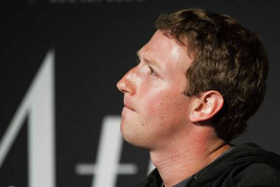 """In this file photo taken on September 18, 2013 Facebook Founder and CEO Mark Zuckerberg speaks during an interview session with The Atlantic at the Newseum in Washington, DC. Zuckerberg, breaking his silence over the data scandal roiling the social network, acknowledged on March 21, 2018, the company made """"mistakes"""" and needs to """"step up"""" to fix the problem. """"We have a responsibility to protect your data, and if we can't then we don't deserve to serve you,"""" Zuckerberg said in his first public comments since the scandal broke."""