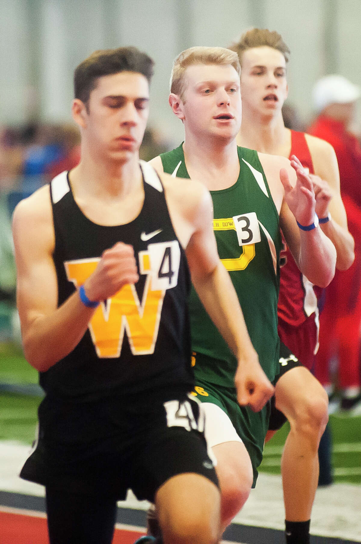 Dow junior Zach Coon, center, competes in the 400 meter dash during the MHSAA Division 1 High School Track and Field Invitational on Wednesday, March 21, 2018 at Saginaw Valley State University. (Katy Kildee/kkildee@mdn.net)
