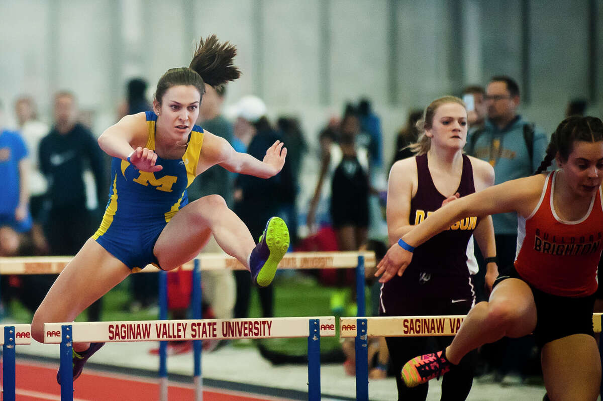 Midland sophomore Edie Haase competes in the 100 meter hurdles during the MHSAA Division 1 High School Track and Field Invitational on Wednesday, March 21, 2018 at Saginaw Valley State University. (Katy Kildee/kkildee@mdn.net)