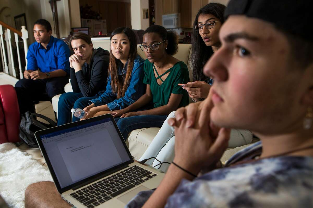 Marcel McClinton, 16, Jack Reid 15, Kelly Choi, 17, Ariel Hobbs, 20, Pavitra Kotecha, 15, Noah Holbein, 15, work on ideas to implement at the March For Our Lives. The march will take place in downtown Houston to send a message intended to reduced gun violence and implement gun control laws. Saturday, March 10, 2018, in Katy. ( Marie D. De Jesus / Houston Chronicle )