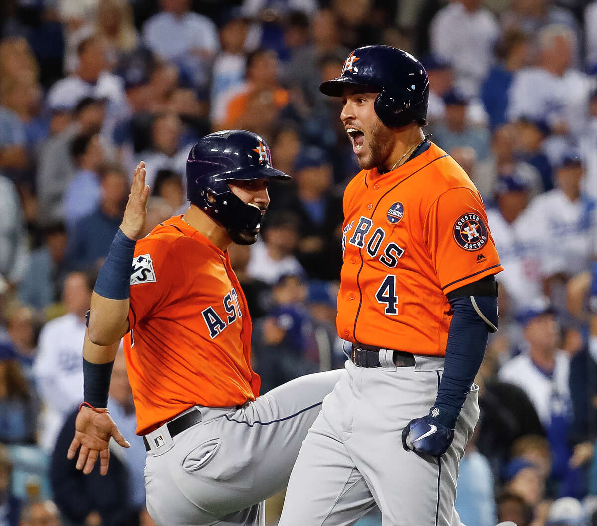 Houston Astros center fielder George Springer (4) and left fielder Marwin Gonzalez (9) celebrate Springer's two-run home run that drove in Gonzalez during the second inning of Game 7 of the World Series at Dodger Stadium on Wednesday, Nov. 1, 2017, in Los Angeles. ( Karen Warren / Houston Chronicle )