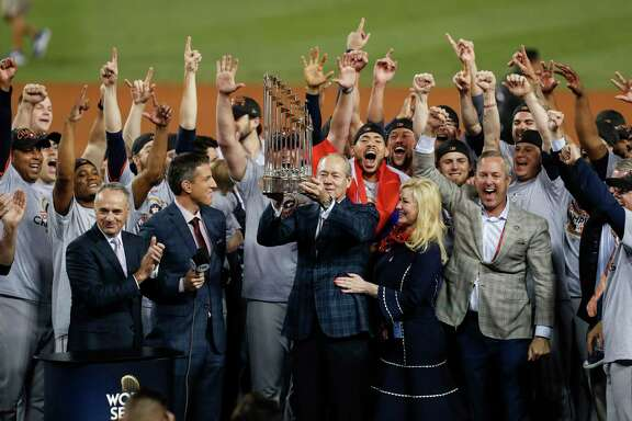The Houston Astros hoist the World Series trophy as they celebrate beating the Los Angeles Dodgers 5-1 in Game 7 of the World Series at Dodger Stadium on Wednesday, Nov. 1, 2017, in Los Angeles. The Astros took the Series 4-games-to-3 to capture the franchise's first title. ( Brett Coomer / Houston Chronicle )
