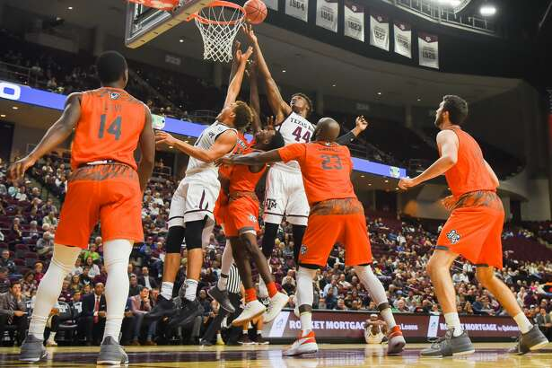 COLLEGE STATION, TX - NOVEMBER 30: Texas A&M Aggie forward Robert Williams (44) and Texas A&M Aggie forward DJ Hogg (1) fight for a rebound underneath during the basketball game between the University of Texas - Rio Grande Vaqueros and the Texas A&M Aggies on November 30, 2017 at Reed Arena in College Station, Texas. (Photo by Ken Murray/Icon Sportswire via Getty Images)