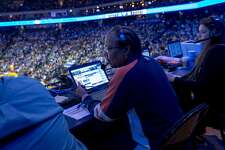 Lori Hoye records stats during the NBA game between the Golden State Warriors and Sacramento Kings at Oracle Arena, Friday, March 16, 2018, in Oakland, Calif. Hoye works in the Warriors' statistics department.