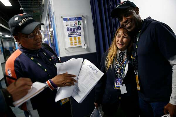 From left: Lori Hoye, security Genene Oviatt and Walter Hoye chat in the tunnel before an NBA game between the Golden State Warriors and Sacramento Kings at Oracle Arena, Friday, March 16, 2018, in Oakland, Calif. The Hoye's work in the Warriors' statistics department.
