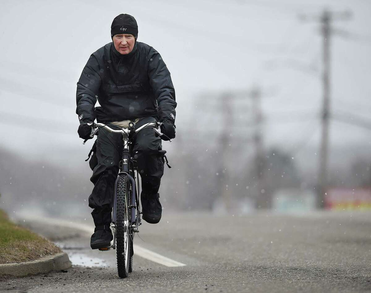 East Haven resident Vic, rides Route 80 during Wednesday's nor'easter as the light wintry mix transitions to snow, March 21, 2018, in the New Haven area. The National Weather Service has a winter storm warning to 6 a.m. Thursday.