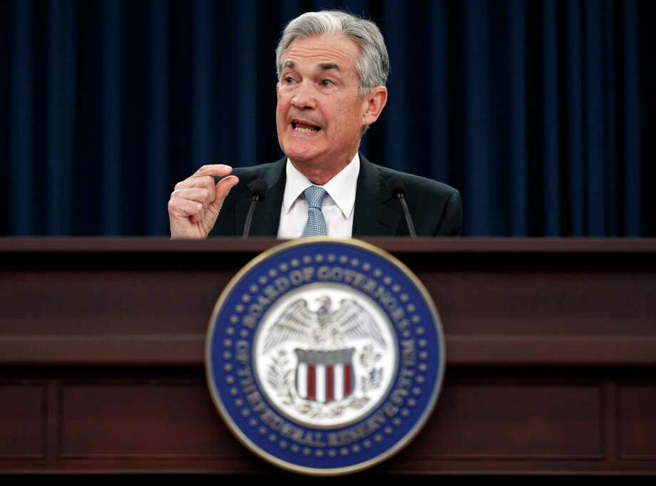 Federal Reserve Chairman Jerome Powell speaks following the Federal Open Market Committee meeting in Washington, Wednesday, March 21, 2018. The Federal Reserve is raising its benchmark interest rate to reflect a solid U.S. economy and signaling that it's sticking with a gradual approach to rate hikes for 2018 under its new chairman, Jerome Powell. (AP Photo/Carolyn Kaster) Photo: Carolyn Kaster / Copyright 2018 The Associated Press. All rights reserved.