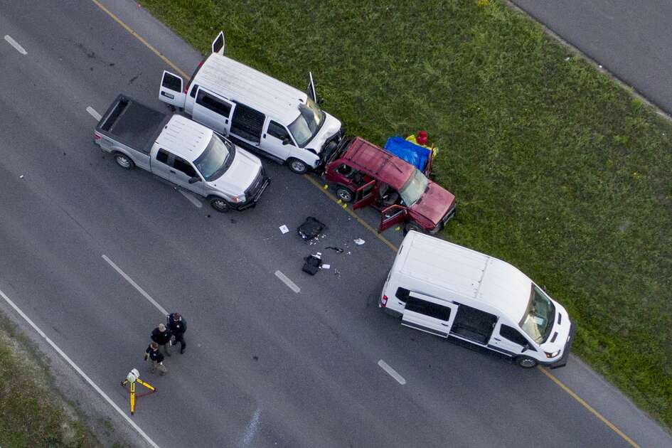 Officials investigate the scene where they say a bombing suspect blew himself up in his vehicle, off of Interstate 35 in Round Rock, Texas, Wednesday morning, March 21, 2018. The 24-year-old white man, named Mark Anthony Conditt, was a suspect in the series of bombings that have terrorized the city of Austin, Texas in recent days, the authorities said. He died in the blast early Wednesday, authorities said. (Jay Janner/Austin American-Statesman via The New York Times) -- AUSTIN CHRONICLE OUT, COMMUNITY IMPACT OUT, TV MUST CREDIT PHOTOGRAPHER AND STATESMAN.COM ON SCREEN, MAGS OUT, NEWSPAPERS ONLY ONLINE. Contact source for special permissions