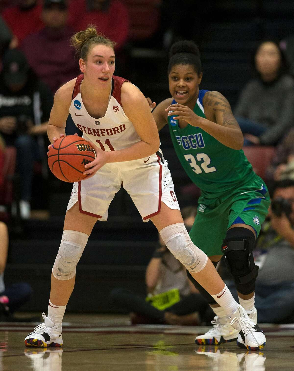 Stanford forward Alanna Smith (11) looks for an open teammate in front of Florida Gulf Coast forward Rosemarie Julien (32) during the third quarter of an NCAA Division I Women's Basketball Championship game, on Monday, March 19, 2018 in Stanford, Calif. Smith led all scorers with 28 points, and Stanford won 90-70, to advance to the Sweet 16.