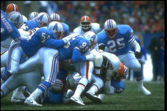 1988:  THE HOUSTON OILERS DEFENSE GANG TACKLES A CLEVELAND BROWNS OFFENDER DURING THE BROWNS GAME AT CLEVELAND STADIUM IN CLEVELAND, OHIO.  MANDATORY CREDIT:  JONATHAN DANIEL/ALLSPORT