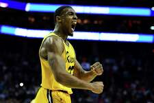 UMBC's Arkel Lamar reacts to his team's 74-54 upset of No. 1 Virginia during the first round of the NCAA Men's Basketball Tournament at Spectrum Center on March 16, in Charlotte, N.C.