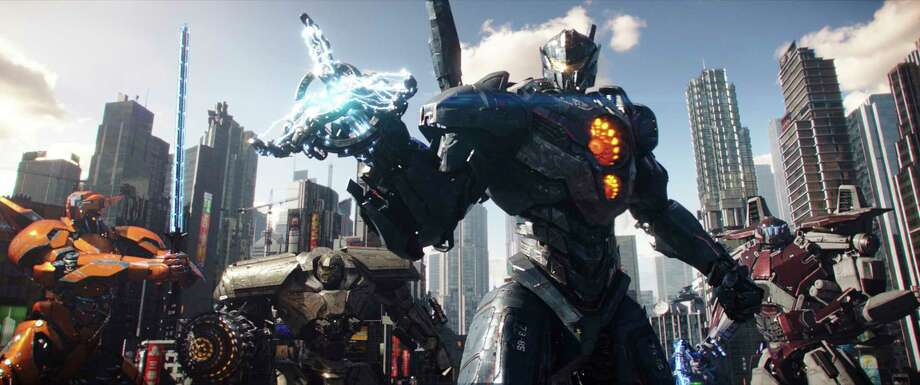 "It's an epic - or some would say mediocre - metal melee when the Jaegers once again battle the Kaiju in ""Pacific Rim Uprising."" Photo: Legendary Pictures, HONS / Copyright: © 2017 Universal Studios. ALL RIGHTS RESERVED."