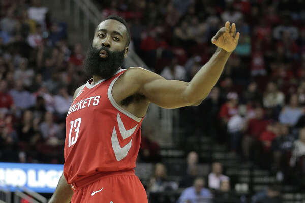 Houston Rockets guard James Harden (13) gestures after scoring a three-point-shot against San Antonio Spurs at the Toyota Center on Monday, March 12, 2018, in Houston. Rockets won the game 109-93. ( Elizabeth Conley / Houston Chronicle )