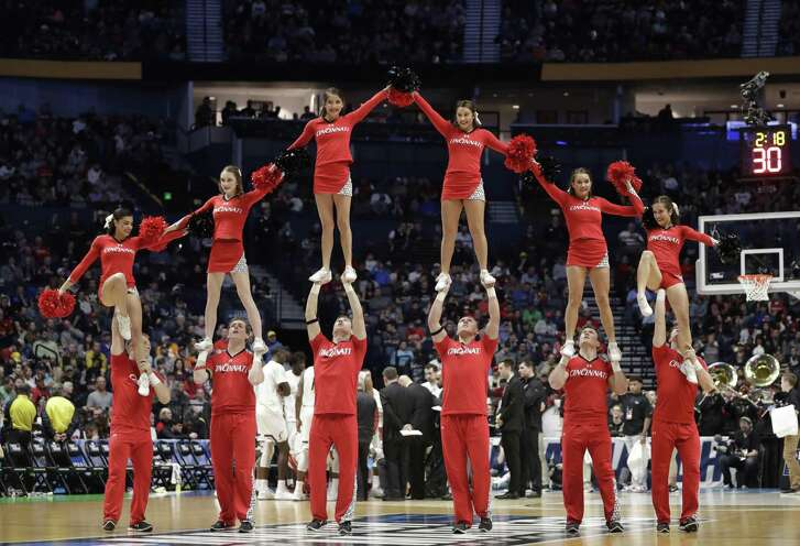 Cincinnati cheerleaders perform during the first half of a second-round game against Nevada, in the NCAA college basketball tournament in Nashville on Sunday.