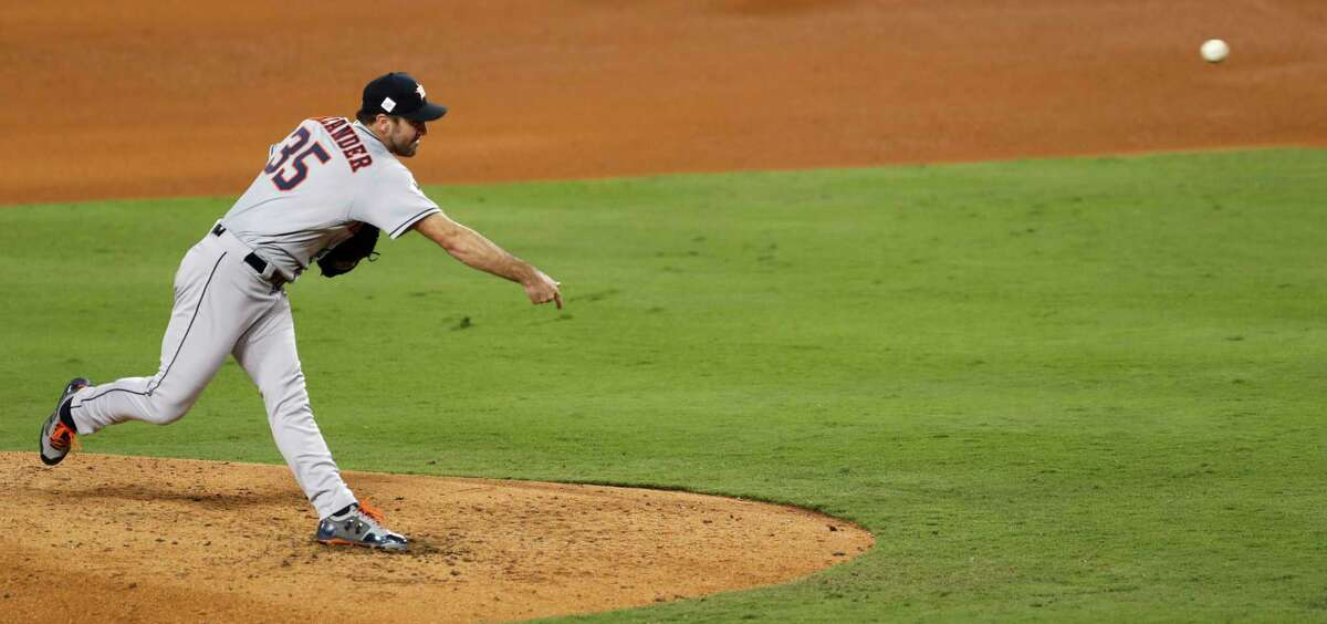Houston Astros starting pitcher Justin Verlander releases a pitch against the Los Angeles Dodgers during the fifth inning of Game 2 of the World Series at Dodger Stadium on Wednesday, Oct. 25, 2017, in Los Angeles. ( Brett Coomer / Houston Chronicle )